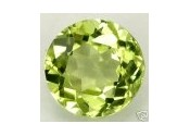 Peridot naturel taille ronde a facettes 7 mm 1.35 carat