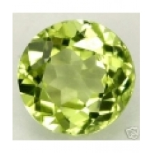 Peridot naturel taille ronde a facettes 6 mm 0.91 carat